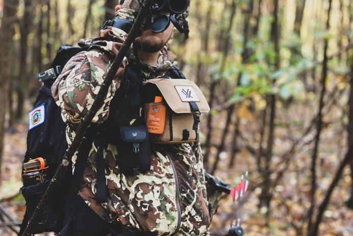 Andrew Spellman looks through binoculars during a whitetail deer hunt in 2020.